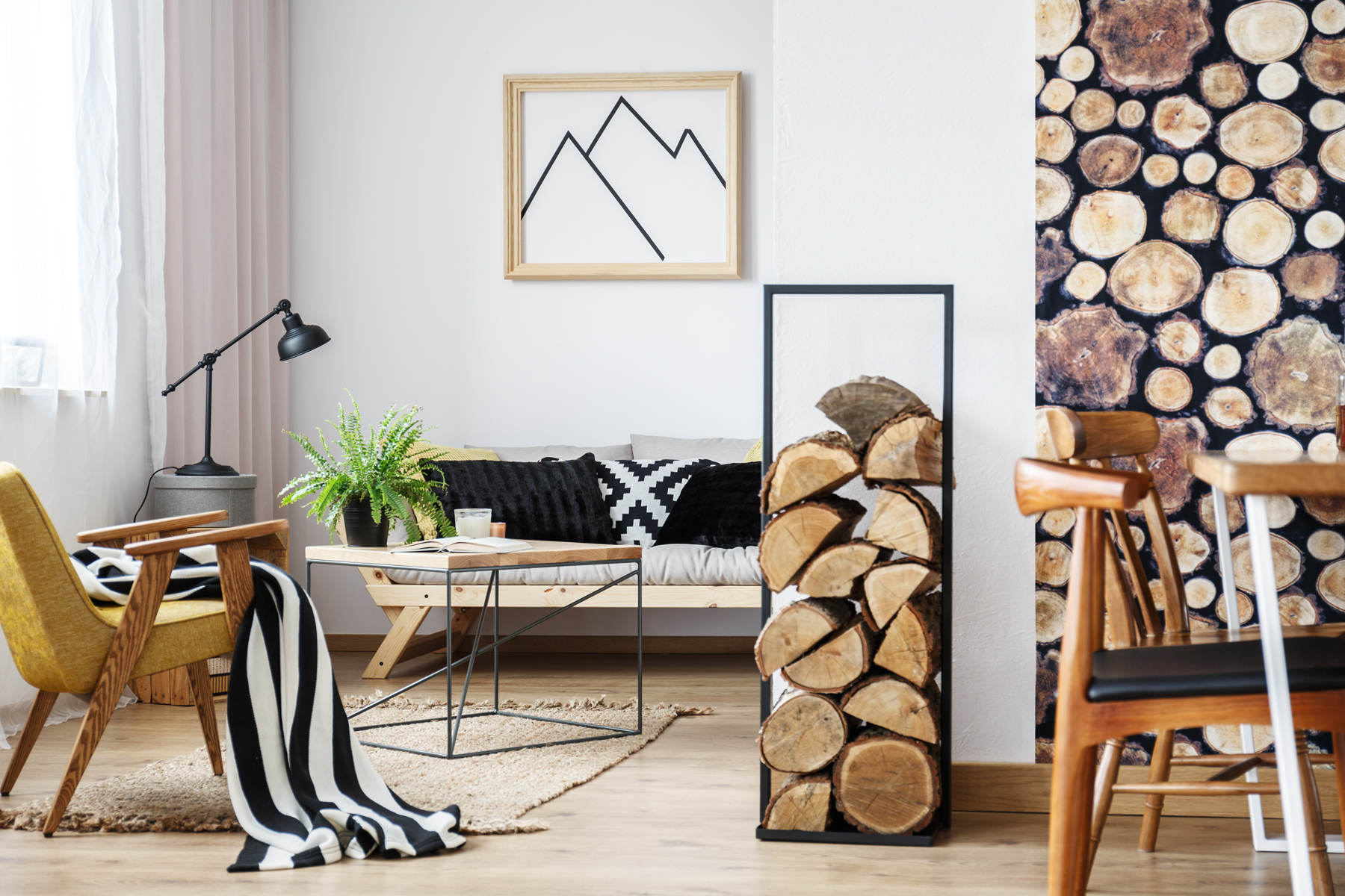 Cozy winter interior design for minimalist with wooden accessories, warm colors and fire logs